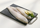 Halibut fillets on chopping board