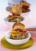 Skewered mini-burger, pumpkin, tomato and baguette