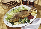 Fried carp, bread and dark beer