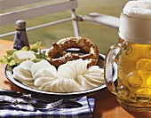 Bavarian 'Brotzeit' with radish, pretzels and beer