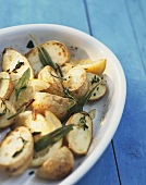 Oven-baked potatoes with lemon, herbs and garlic