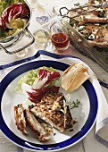 Grilled pork chop with salad and baguette