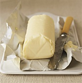 Butter on butter paper with knife