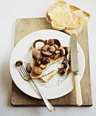Toast with butter and fried mushrooms