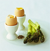 Two soft-boiled eggs and green asparagus