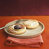 Puff pastry tart with fruit and icing sugar
