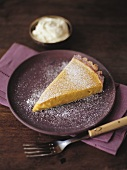 Piece of pumpkin pie with icing sugar