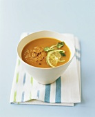 Pumpkin and coconut soup with lime and coriander leaves