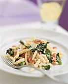 Pasta (trofie) with pancetta and broccoli