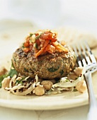 Lamb burger with tomato chutney on bean and fennel salad