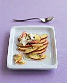 Peaches with lime sauce, rose petals, cream, pistachios