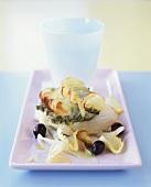 Cod with crispy potato crust, pesto and olives