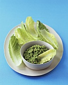 Pea dip with romaine lettuce leaves
