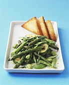 Green summer vegetables with butter sauce & toast triangles