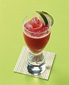 Tomato and watermelon drink with lime wedges