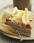 Cheese baked in wooden box with chicory