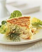 Piece of shrimp tart with salad garnish