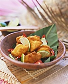 Deep-fried chicken fillets with lime and chili (Caribbean)