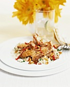 Pork with chili, pine nuts and couscous