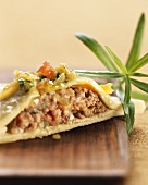 Pasta envelopes with mince filling and onions