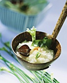 Rice soup with nori and jelly ear fungus in ladle (Japan)