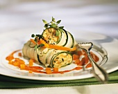 Courgette roulades with pepper sauce