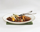 Venison ragout in red wine sauce with fruit and nuts