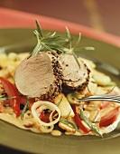 Pork fillets with pepper crust on vegetables