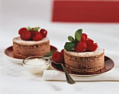 Small chocolate cakes with fresh raspberries