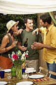 Friends drinking wine at start of barbecue