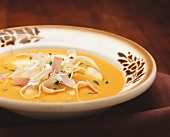 Apple and carrot soup with ham and horseradish