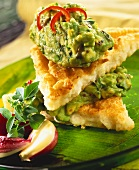 Fried bread with coconut, sandwiched with guacamole