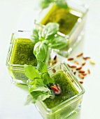 Three types of pesto in glass bowls