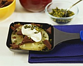Pineapple raclette with chocolate, cream and pistachios