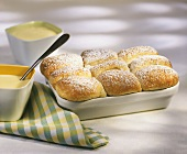 Sweet rolls (Buchteln) with icing sugar and custard