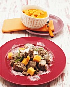 Poppy seed Schmarrn (pancake pieces) with mango compote