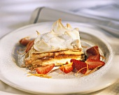 Tower of pancakes with meringue, jam and strawberries