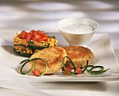 Fish cakes with vegetables and yoghurt sauce