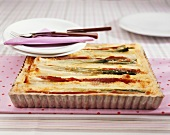 Asparagus and spring onion tart in baking dish