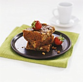 Three pieces of apple cake with fresh strawberries