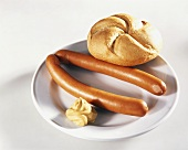 Frankfurter with bread roll and mustard
