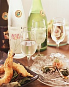 Fresh oysters, shrimps in batter and white wine