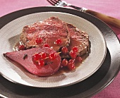 Venison fillet with redcurrants and pear