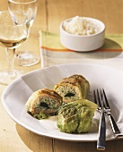 Savoy cabbage roulade with salmon and cod