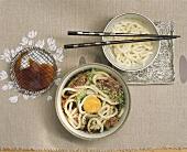 Sukiyaki soup with beef and noodles (Japan)