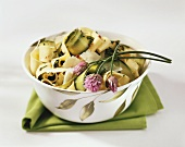 Wide ribbon pasta with courgettes and chive flowers
