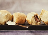 Sweet nougat rolls with spoonful of custard