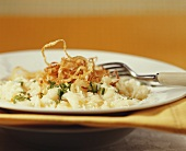 Cheese spaetzle noodles with deep-fried onions