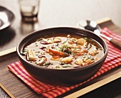 Pork soup with chili and peppers
