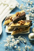 Walnut diamonds, half coated in chocolate, for Christmas